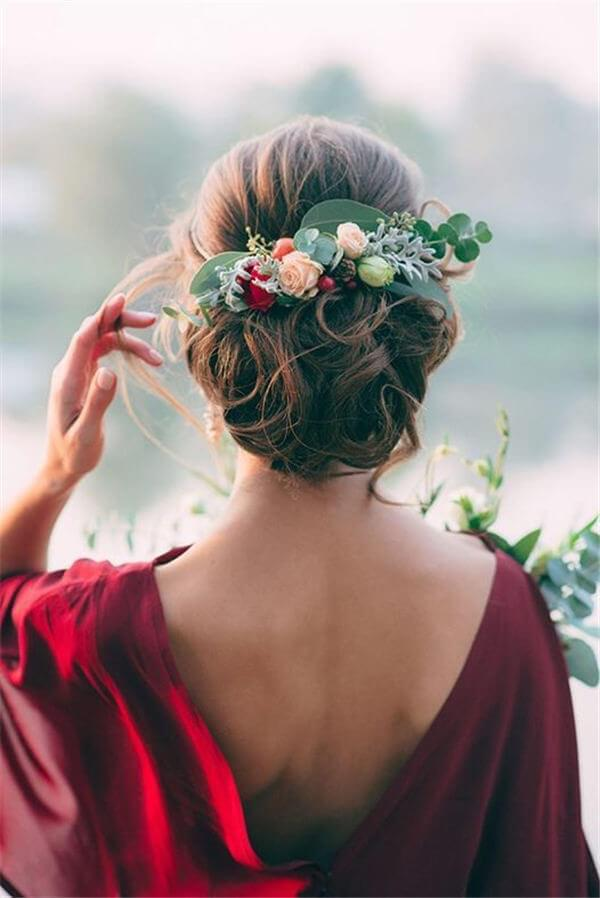 Greenery and flowers adorned in a hair updo