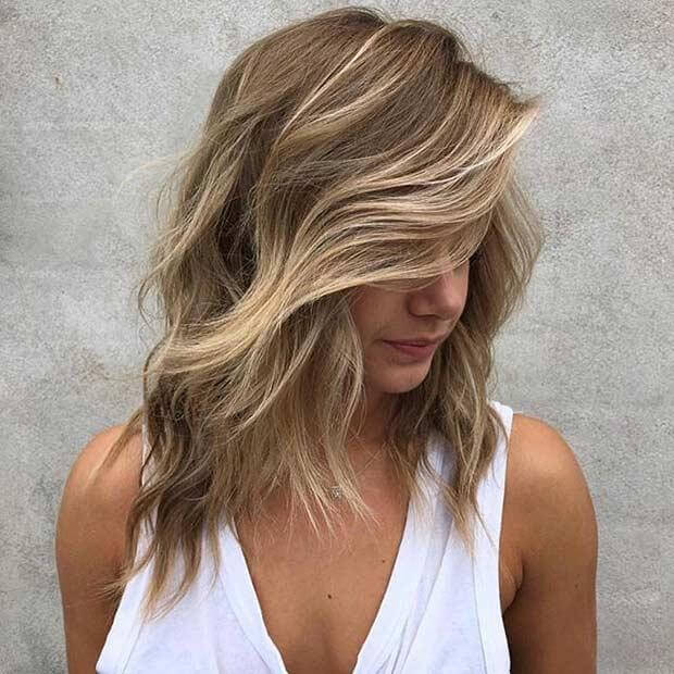 Voluminous Honey Blonde Hairstyle