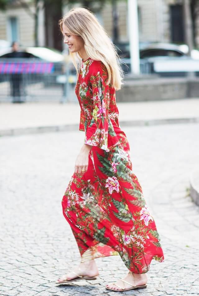Model sports a bohemian style long dress with flats for a casual stroll