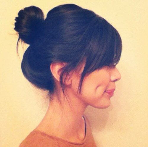 Keep it short and simple with bangs and a bun.