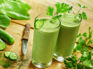 Cilantro and cucumber smoothie with leafy toppings