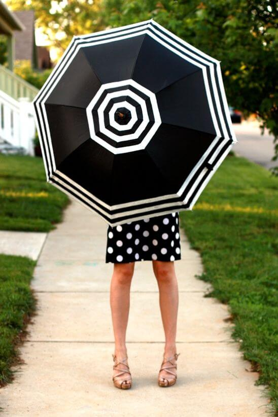Add suave to your look by accessorizing with a stylish striped umbrella.