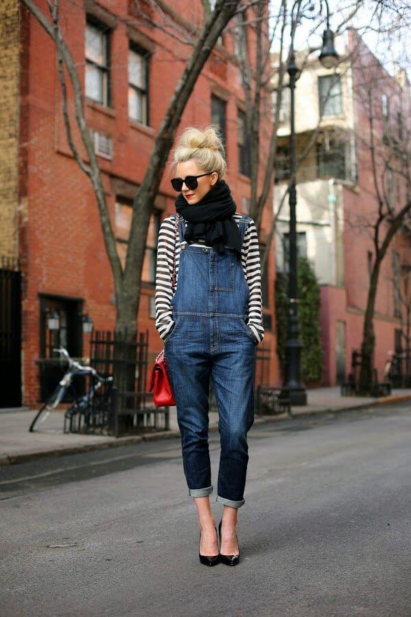 Model looks comfy in a denim jumpsuit, black heels and striped top