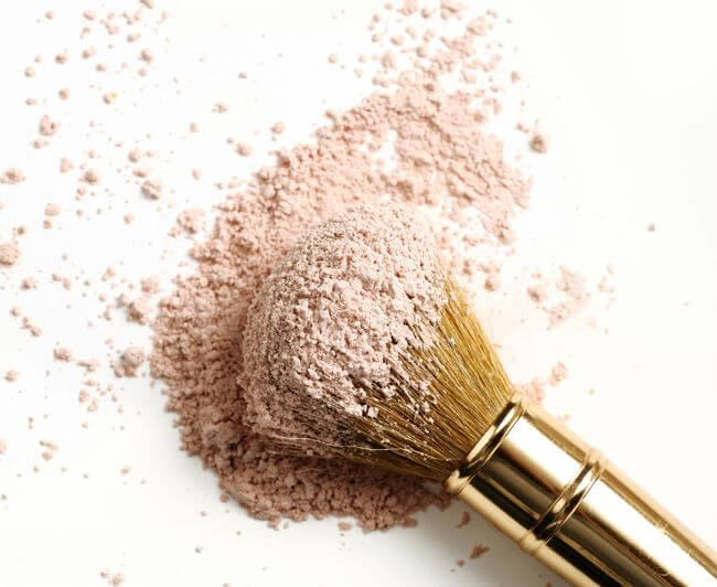 A makeup brush in powder