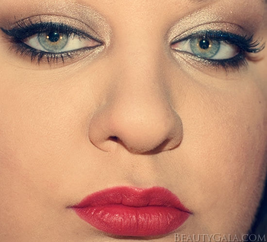 Dramatic gold eyes with eyeliner and mascara and red lipstick