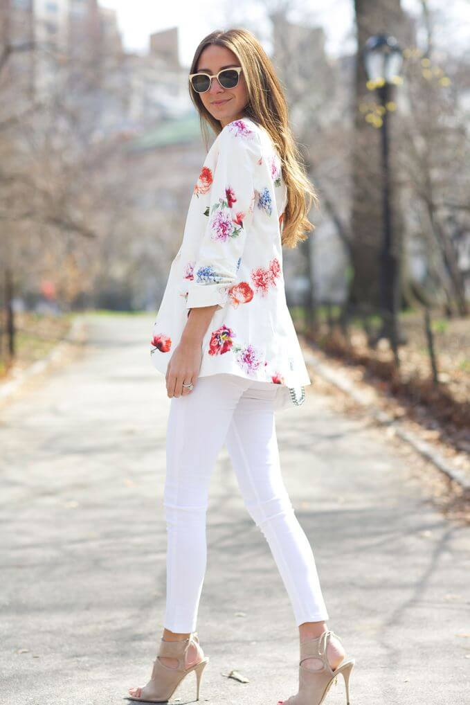 Model in floral top and white jeans, heels to finish