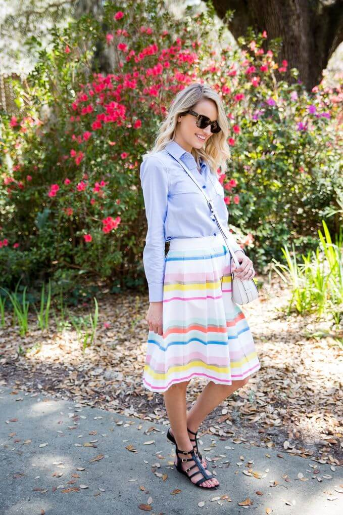 Look flirty in this light-colored stripe skirt, a light blue top, sling bag and black flats to complete the look.