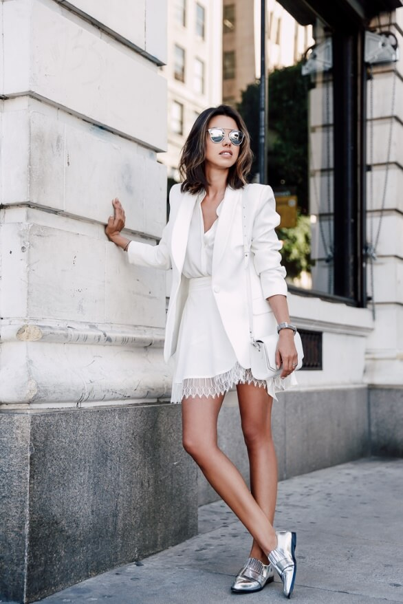 Model makes a more stylish outfit with her silver glasses, bracelets and loafers