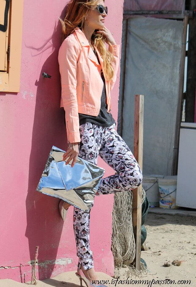 Model mix matching color combinations, a metallic clutch bag and heels with a neon jacket highlights the look