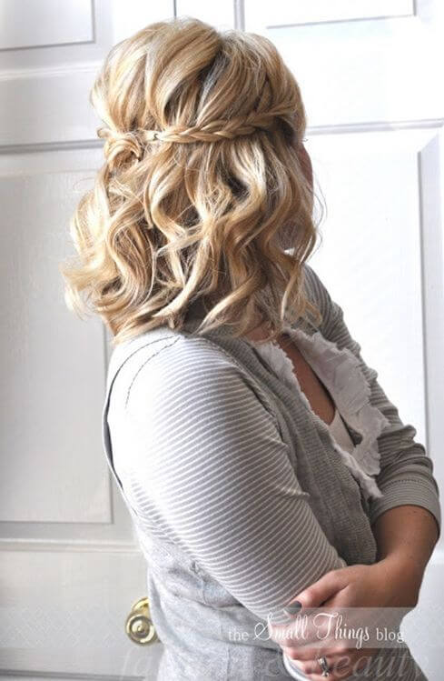 Pitch together curls by backcombing crown and braid frontal strands to bring it to the back and pin it up