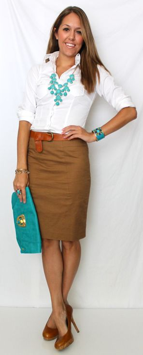 Model is wearing a simple white shirt, brown pencil skirt and pumps, aquamarine bag, necklace and a bracelet to have as accessories