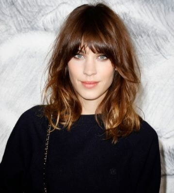Go wild with this shoulder length curly do and bangs.