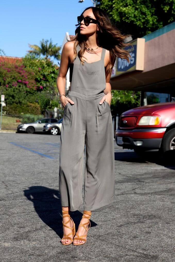 Model rocks a silk jumpsuit with orange heels