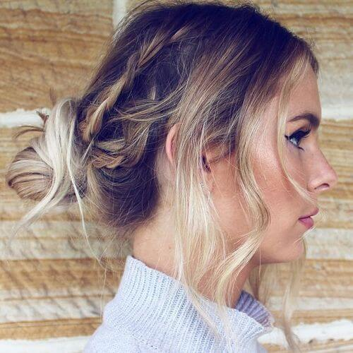 Model wears a messy braid and tied in a loosely tied hair knot