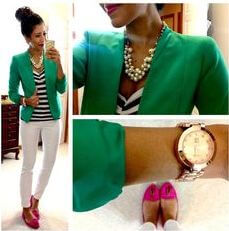 Model shows off her striped blouse under her green jacket, pink shoes to add color and her classy accessories to add points