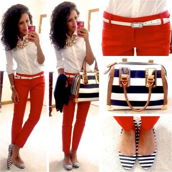 Model is wearing striped flats to finish her outfit of white shirt, red pants and a striped bag as well