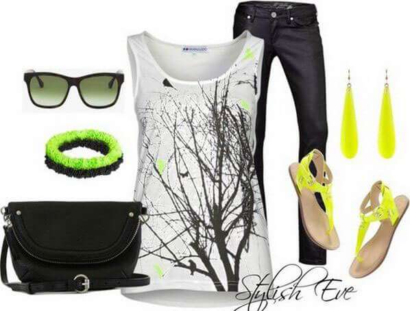An artsy top with touches of yellow, black jeans, neon yellow earrings and sandals with a black bag and Ray Bans for added spunk