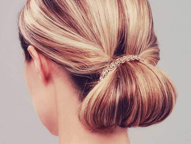 Steps illustrated on getting this low rolled bun look