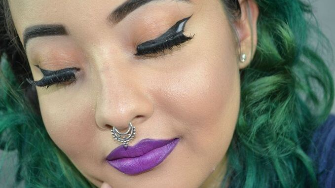 Winged liners are becoming increasingly popular with its black and white effect.