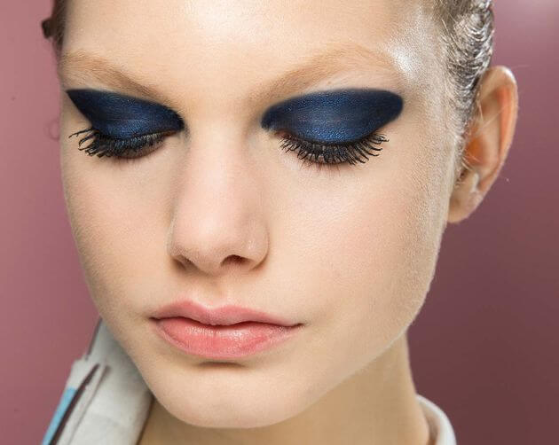 Model has different shades of blue on her eye shadow