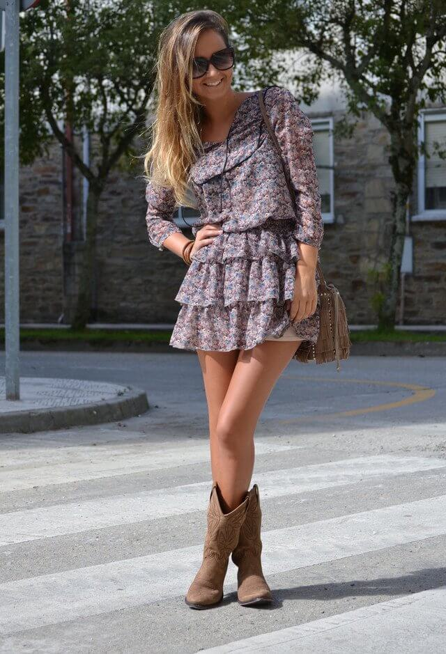 Look fun and interesting with a cute floral dress, brown leather bag, statement glasses and leather boots to slay the outfit