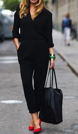 Model is wearing a black jumpsuit with red stilettos, bangles to accessorize and an oversized bag to complete the look