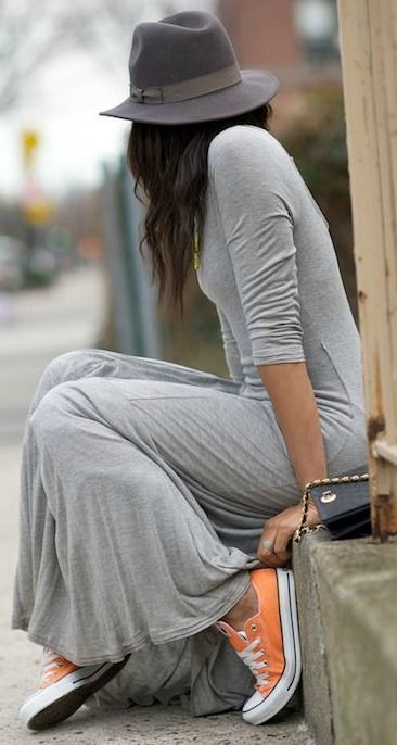 A girl in a gray lightweight cotton dress and classic sneakers. Dress looks good with sneakers.