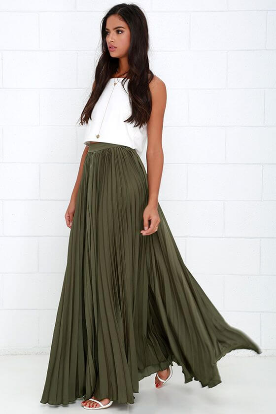 Elegant woman in olive green maxi skirt and white top combination. Olive green skirt and white crop top.