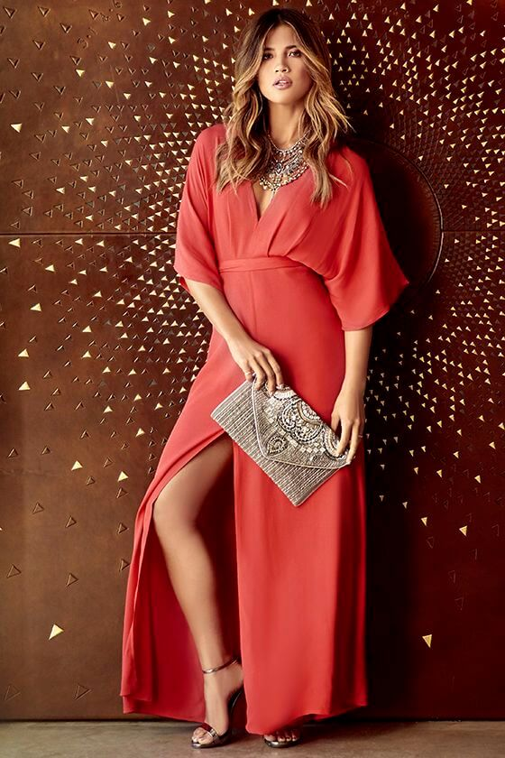 gorgeous woman in dark coral dress and sparkly accessories