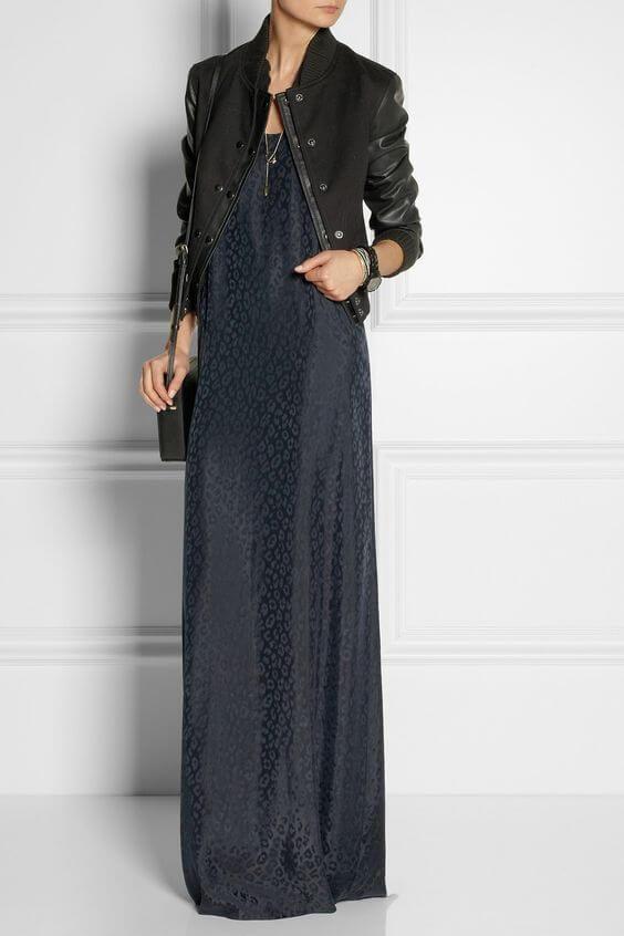 Woman wearing dark blue dress with a delicate leopard print