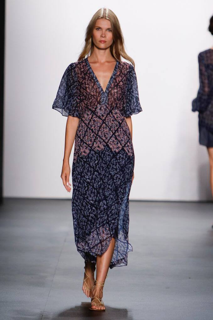 Model in an elegant dark blue maxi dress