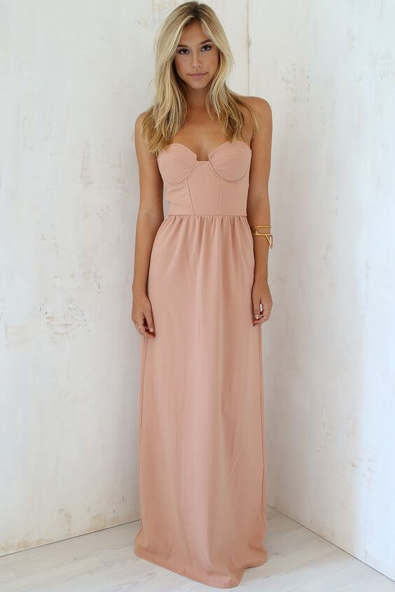 Girl with long dress looking elegant and feminine