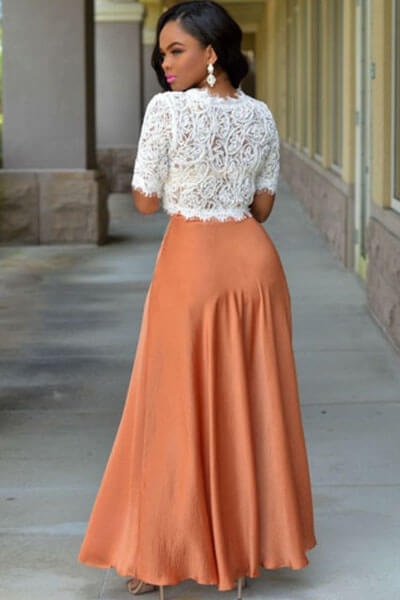 Woman in long orange skirt with white lace blouse