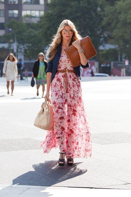 Young woman in pink light dress with micro flowers, wearing sandals