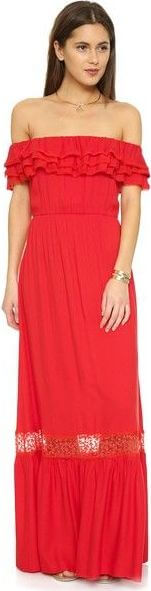 Girl in a expressively red off-the-shoulder maxi dress