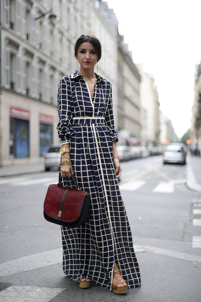 Woman in the street with a vintage style long maxi dress, together with platform heels. Great outfit with a vintage style long maxi dress.