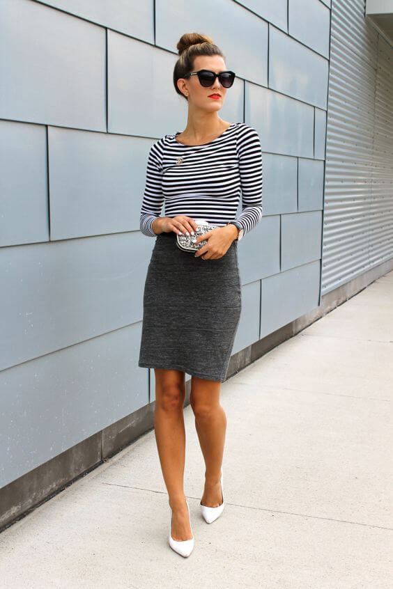 Model paired an easy shift skirt with a striped top, white pointy pumps to complete the look
