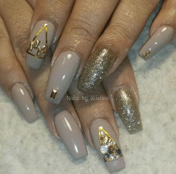 Long taupe nails with gold shimmer and gems