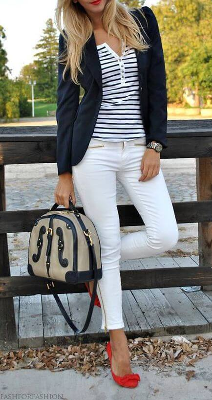 Model steals the show in classic white skinny jeans, navy blue blazer and a Breton-inspired button-down top with a pop of bright red ballet shoes
