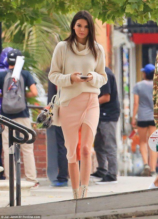 Model opted for a chunky woolen knit to accompany her pink wrap skirt, Christian Louboutin Lady Tuscan boots to add pizzaz