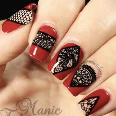 Red nails with stamp designs