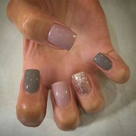 Nails in different colors and glitter added