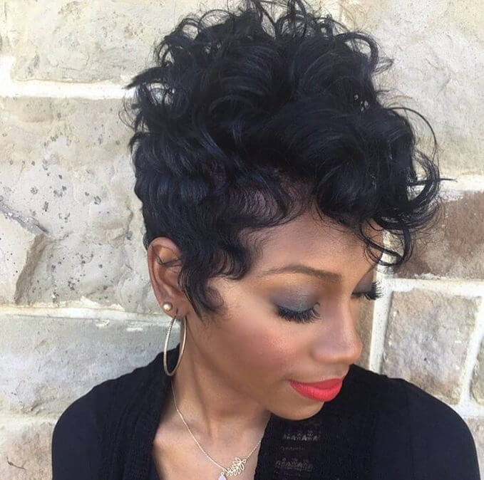A curly pixie cut with tapered sides