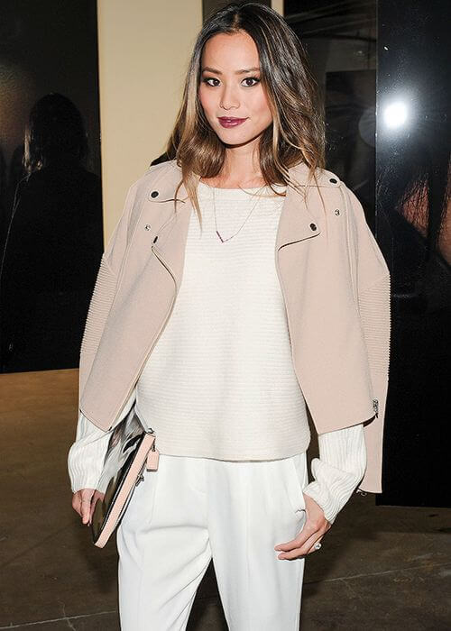 Lush Layers: Creamy colors like ivory white and porcelain pink brighten up naturally lightly tanned skin like Jamie Chung.