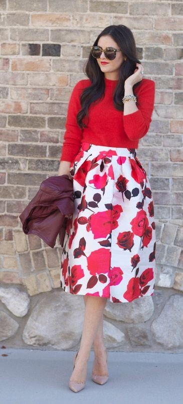 Lady in fiery red top and floaty skirt