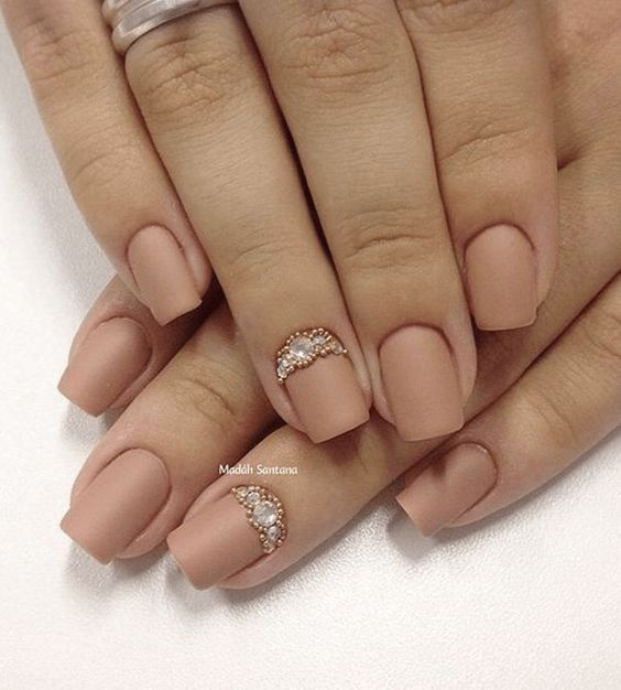 Nude matte nails with embellished silver and gold beads
