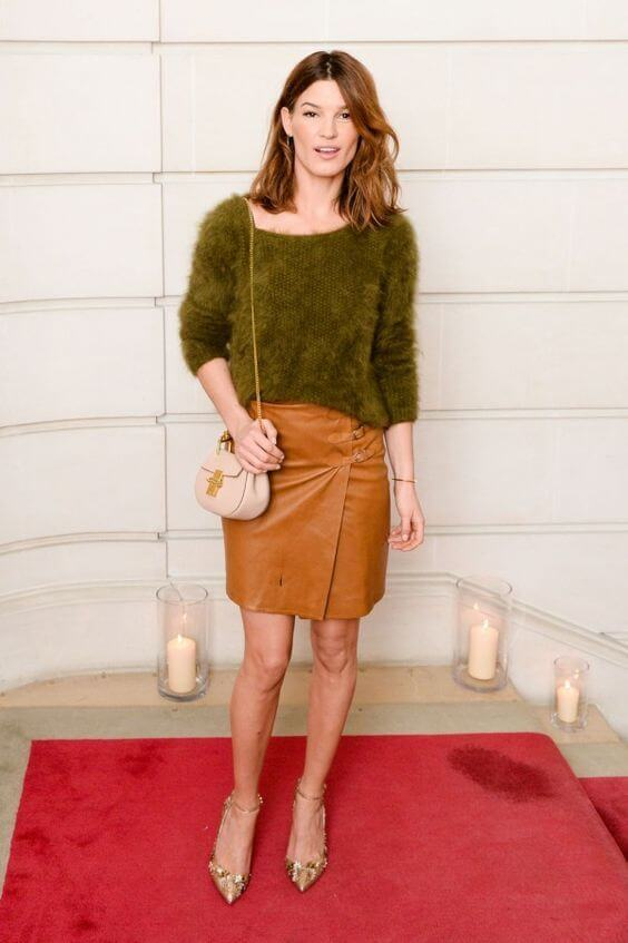 Model looks great in a furry olive green sweater, mustard wrap skirt and sparkly pointy-toed pumps