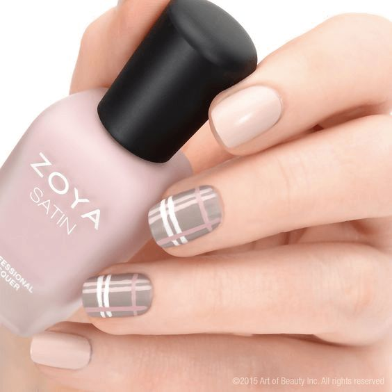 Liven up your nude nail polish by doing a plaid nail art.