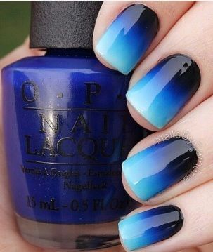 Cool blues are seen on these nails in an ombre tone