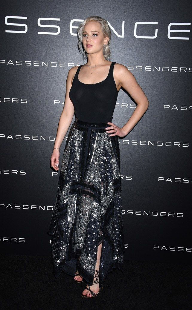 Model steals the spotlight in a simple black tank, a silver embellished patchwork skirt and beaded sandals to complete the look